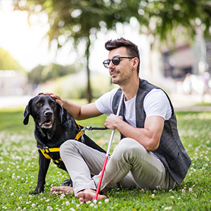 Visually impaired man with dog outdoors